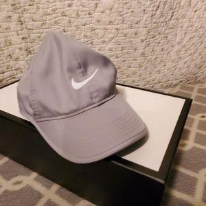Nike, silver nylon, baseball cap. Nike swoosh.